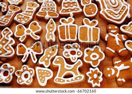 A wide variety of Christmas cookies. All brightly colored cookies. Isolated on white background.