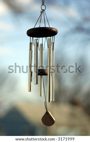 A Wind chime isolated against a natural background