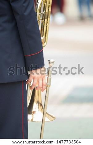 A wind instrument parade - a man holding a trumpet #1477733504
