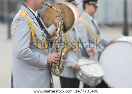 A wind instrument parade - a man playing saxophone #1477733498