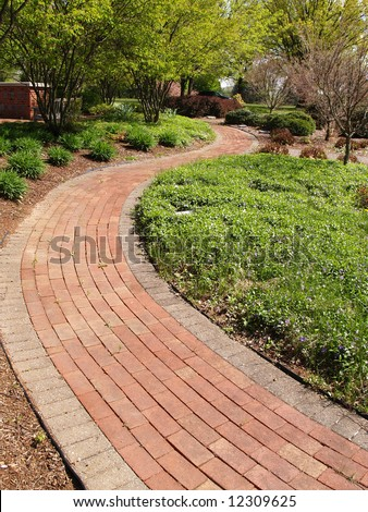 a winding brick path in a garden