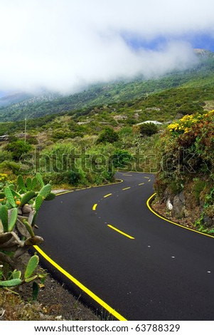 a winding mountain road below the clouds, La palma, Canary Islands
