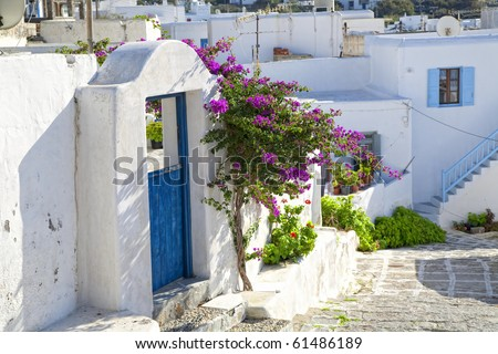 A winding road through a small town on the island of Mykonos, Greece.