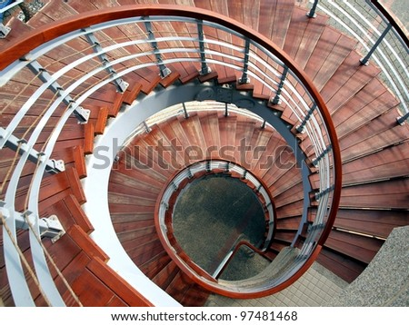 A winding staircase with steps made from wood