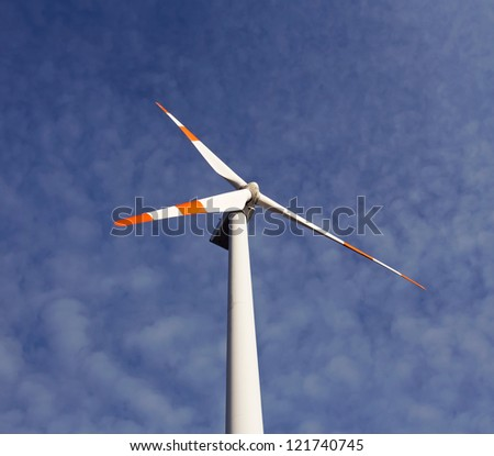 A windmill against a blue sky - stock photo