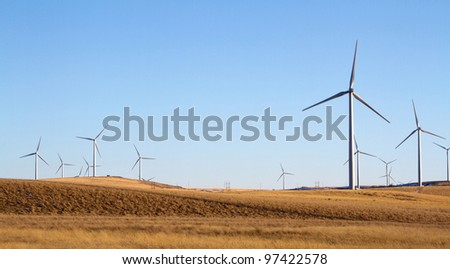 stock-photo-a-windmill-farm-on-a-rural-landscape-energy-conservation-concept-97422578.jpg