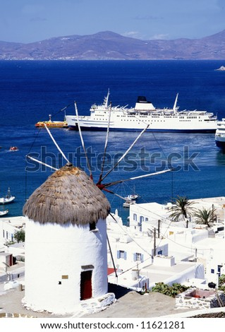 A windmill overlooking the harbour of Mykonos a greek island