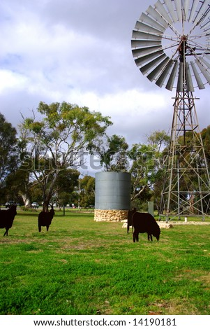 A windmill & watertank at Tintinara (Australia), including a display of agricultural animals made from metal.