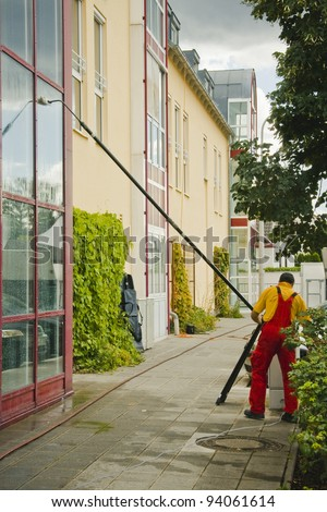A window cleaner when cleaning an office building
