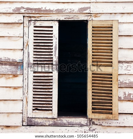 A window  in the old wooden house