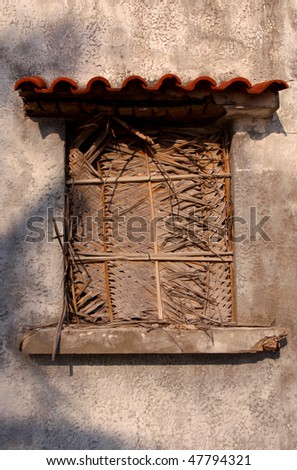 A window of a deserted building in Mozambique