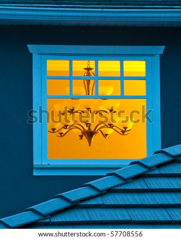 A window of a house at night in Vancouver, Canada. - stock photo