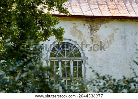 Photo of A window of an old medieval protestant church, Estonia. High quality photo. Selective focus