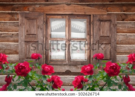 A window with shutters in the old wooden house