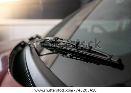 A windscreen wiper or windshield wiper is a device used to remove rain, snow, ice and debris from a windscreen or windshield - Shutterstock ID 745205410