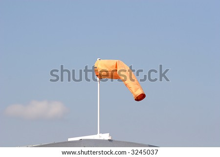 A windsock at an airport showing light winds