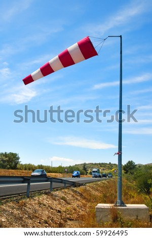 a windsock inflated by the wind on a road