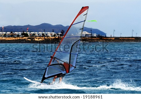 A windsurfer sailing off the coast of Lanzarote