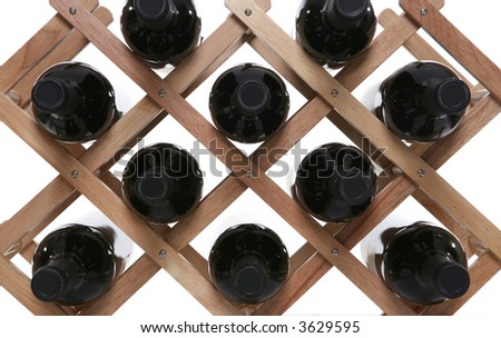 A wine rack holding several filled bottles of wine