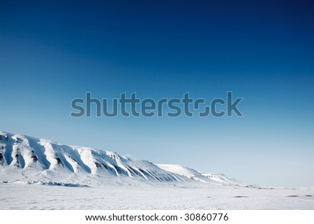 A winter mountain landscape of the island of Spitsbergen, Svalbard, Norway