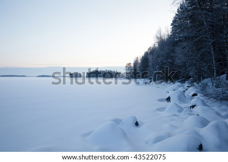 A winter nature shot with beautiful snowy terrain. Very cold weather.
