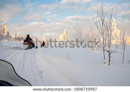 A winter ride on a snowmobiles, winter landscape and snowmobile track, Vuokatti, Finland Stock photo ©