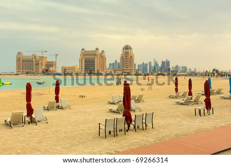A winter view across Katara Beach, West Bay, Qatar, towards the Doha skyline, during one of the few cloudy winter days. - stock photo