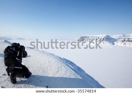 A winter wilderness adventure guide.  Spitsbergen, Svalbard, Norway - stock photo