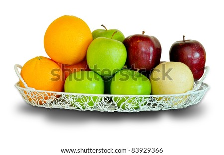 a wire basket full of fresh fruit and vegetables, isolated on a white background.