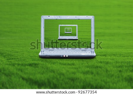 A wireless laptop on the green grass
