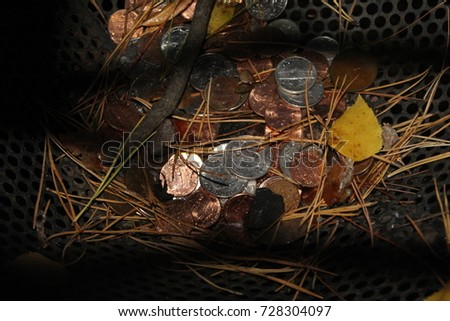 A wish well with coins with the wishes of people. #728304097