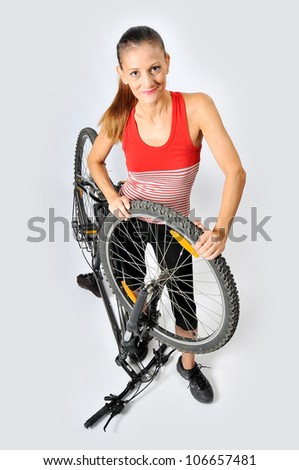 A woman and a broken bicycle