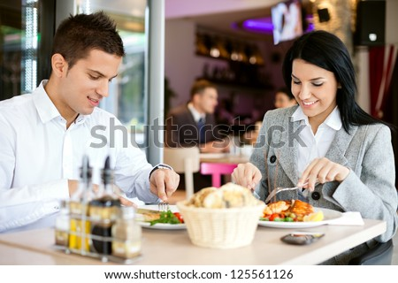 A woman and a man on a business lunch in a restaurant