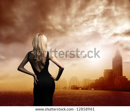 a woman and a view of a city
