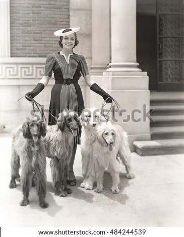 A woman and her four Afghan Hounds