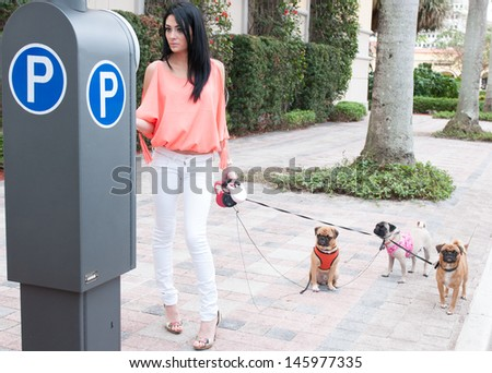 A woman and her three dogs out for a walk