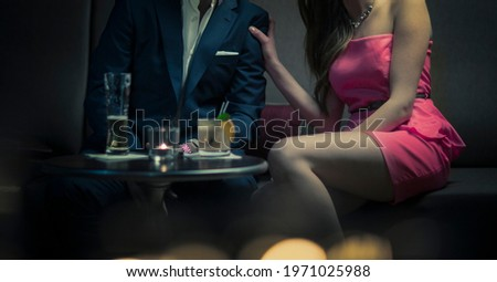 A woman and man flirting with drinks at a bar Stock photo ©