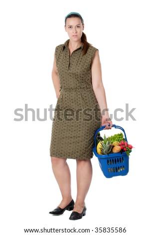 A woman as a shopper with shopping basket on white.