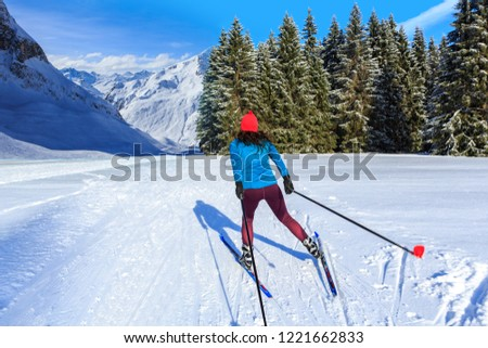 A woman at cross-country skiing or langlauf running in the wintry forest #1221662833