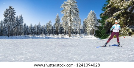 A woman at cross-country skiing or langlauf running in the wintry forest #1241094028