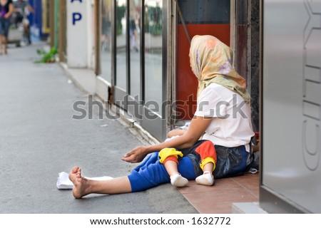 A woman beggar asking for money in Skopje, Macedonia