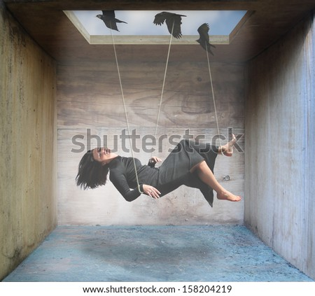 Stock Photo a woman being carried by birds in a box