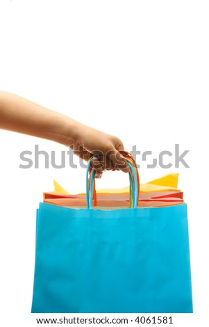 A woman carrying a bunch of shopping bags