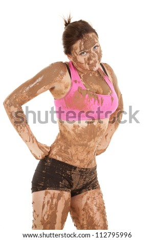 a woman covered in mud with a funny expression on her face with her hands on her hips