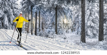 A woman cross-country skiing in the wintry landscape of Norway #1242238915