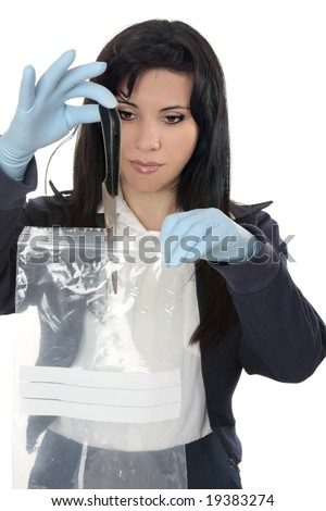 A woman detective collects a blood stained knife from a crime scene
