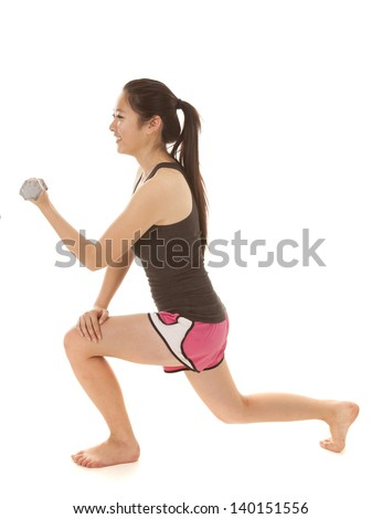 A woman doing a lunge while working out with her weights.