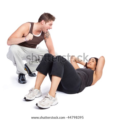 A woman doing situps with her personal trainer
