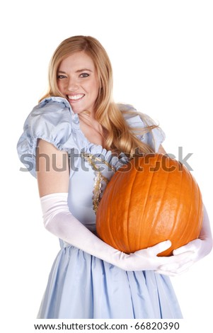 A woman dressed like Cinderella is holding a pumpkin.