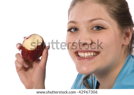A woman eating healthy by biting into a big red apple.